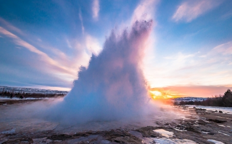 Sun Setting Behind The Eruption Of Strokkur