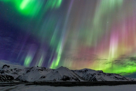 A Colourful Display Dazzling Over The Mountain Tops