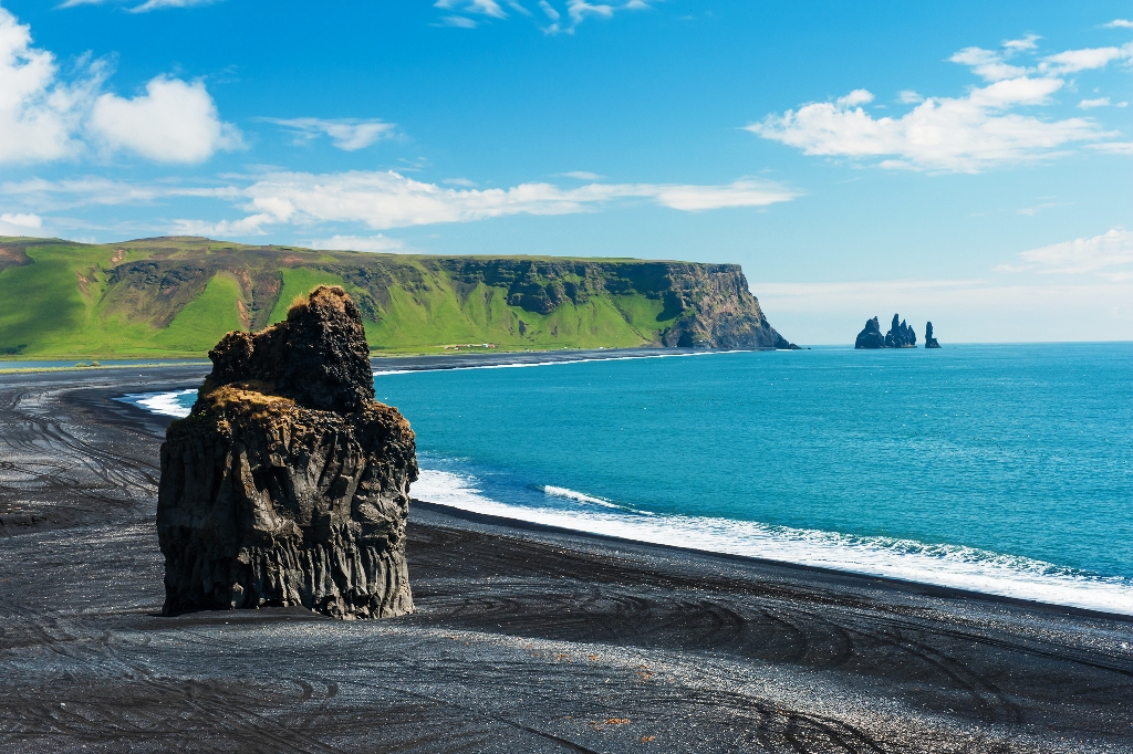 Beautiful Rock Formation On A Black Volcanic Beach