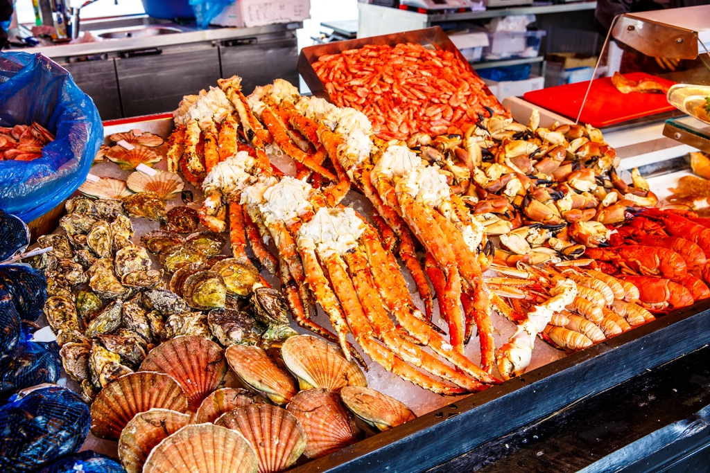 Various Seafood On The Shelves Of The Fish Market Nordic